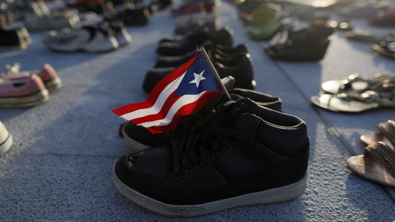 Puerto Ricans honor hurricane dead as estimates rise