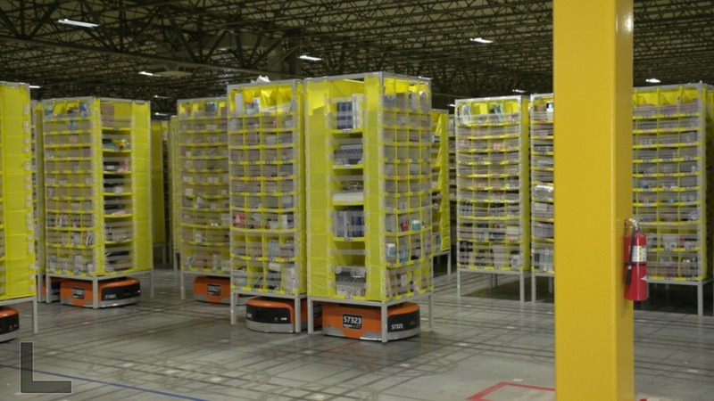Humans reap benefits of Amazon's robot army