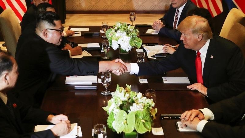 INSIGHT: Trump and Kim sit down for talks