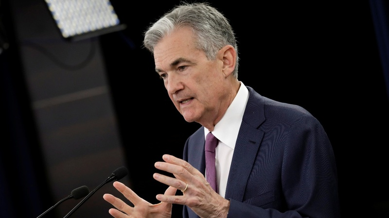 Fed hikes rates, sees two more this year