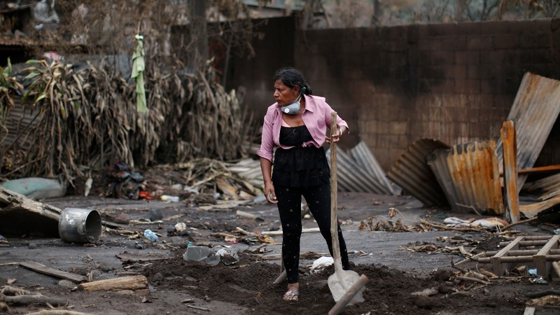 Woman digs for family after Guatemala eruption