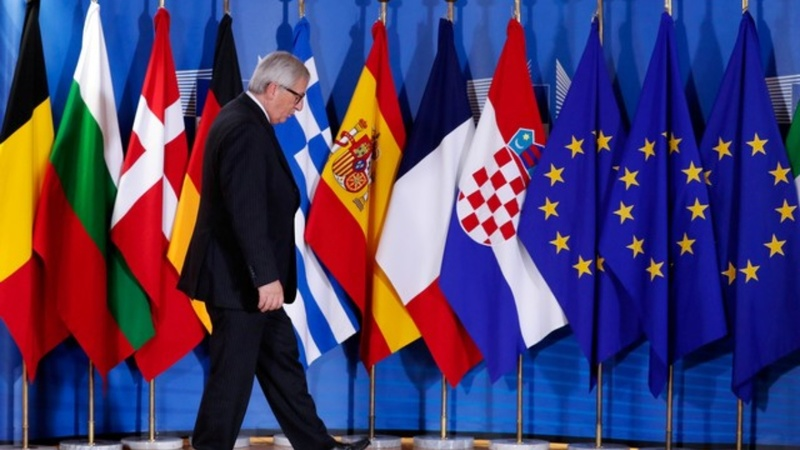 Tense EU summit ends in vague deal over migration