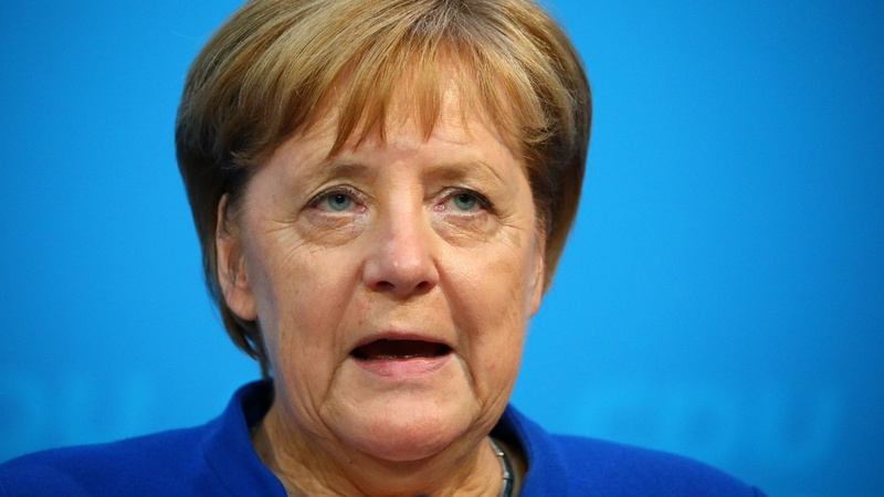 Germany's Merkel reaches deal over migration row