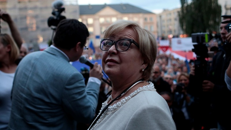 Poland's top judge defies order to quit