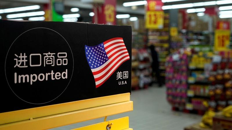 U.S. tariffs on China kick in, Beijing responds