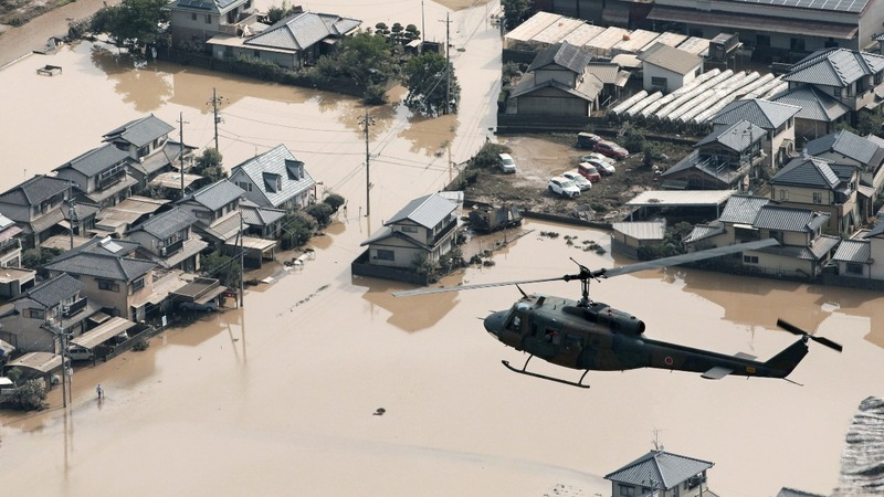 Floods in western Japan kill over 100