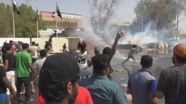 Police tear gas puts Iraqi protester in a coma