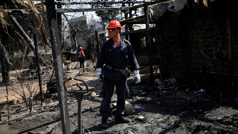 Rescuers search for the missing after Greek fire