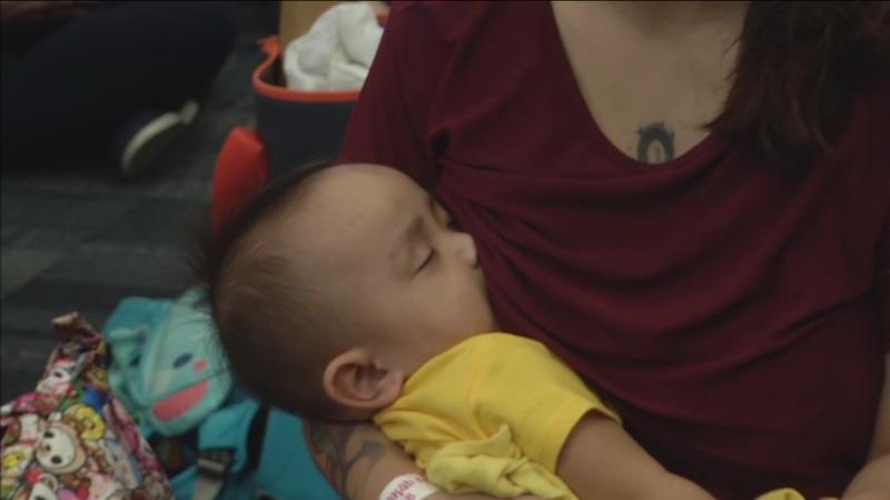 INSIGHT: Filipino mothers hold mass breastfeed