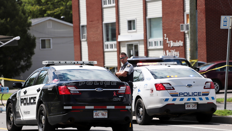 Two police among four dead in Canada shooting