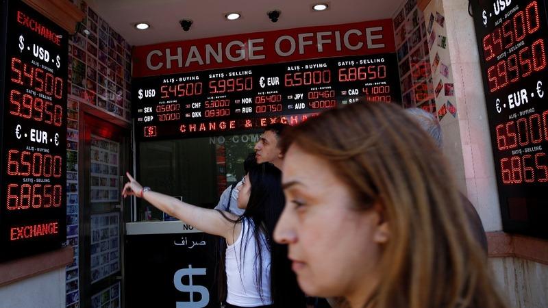 Asia shares dip as Turkey's lira tanks