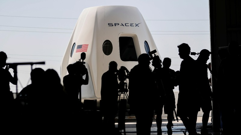 SpaceX displays spacecraft and first crew
