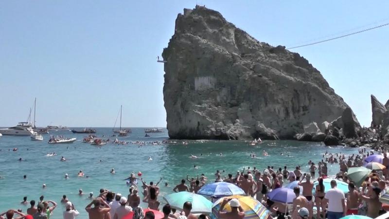 INSIGHT: Divers brave high cliff jump in Crimea