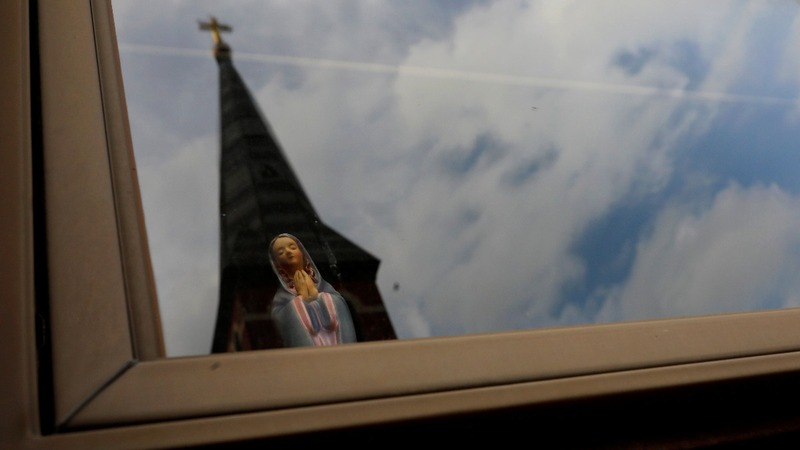 Catholics stand by their faith after sex abuse report
