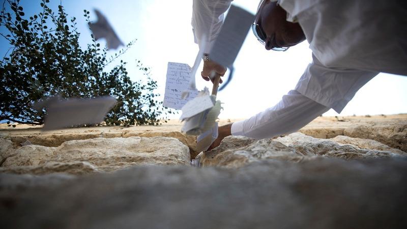 INSIGHT: Jerusalem empties 'God's inbox'