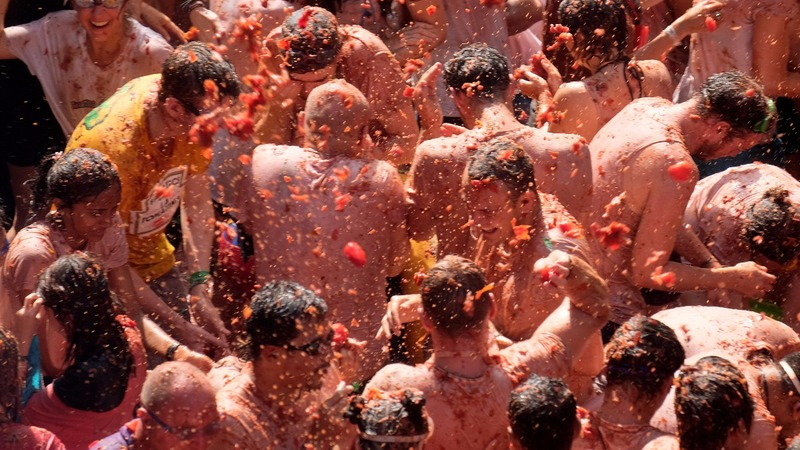 INSIGHT: Spain throws 145-ton tomato fight