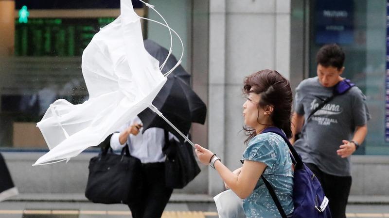 Japan typhoon kills 11 and causes travel havoc