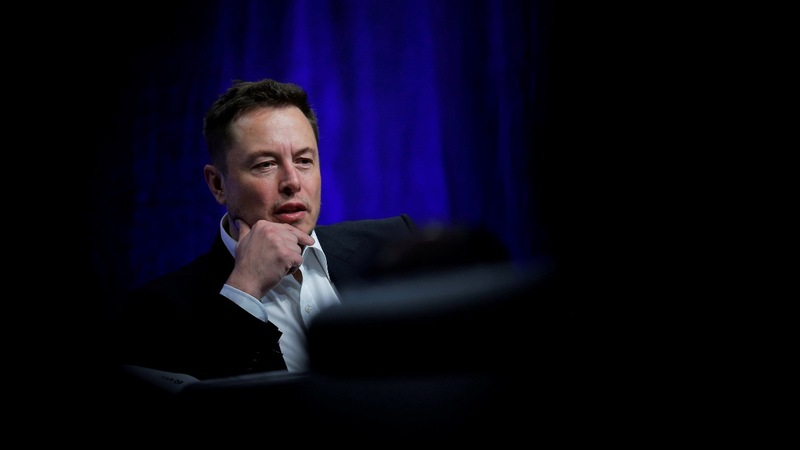 Tesla shares drop after top exec quits, Musk tokes