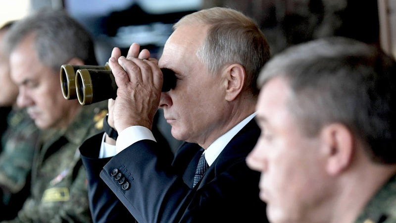 INSIGHT: Putin watches Russia's largest war games