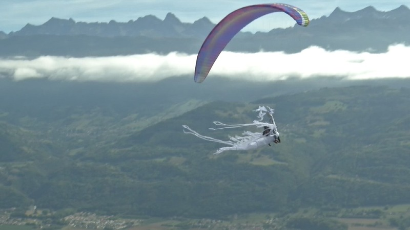 INSIGHT: Costumed paragliders color French sky