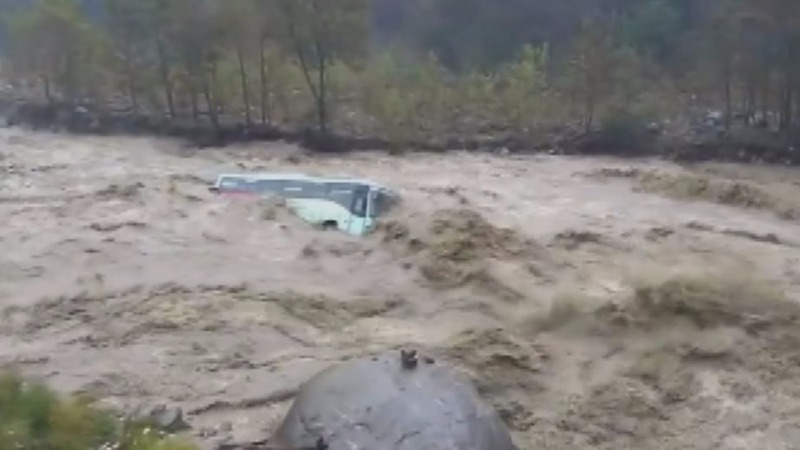 INSIGHT: Floods wash away bus in northern India