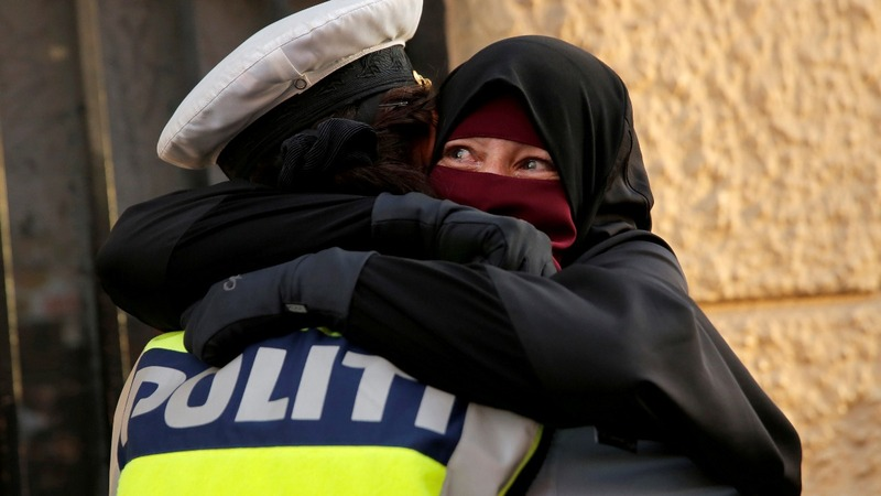 Danish policewoman investigated for protest hug
