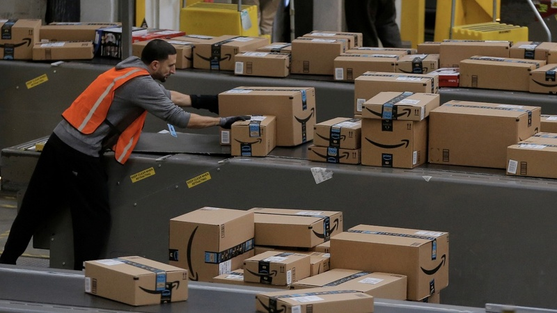 Amazon bows to pressure with wage hike