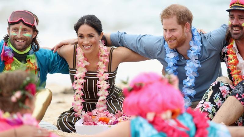 Prince Harry and Meghan group hug on Bondi beach