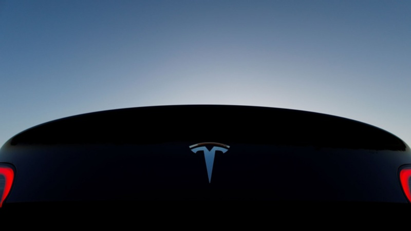Tesla posts profit; shares soar