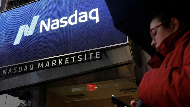 Nasdaq plunges, S&P erases gains for the year
