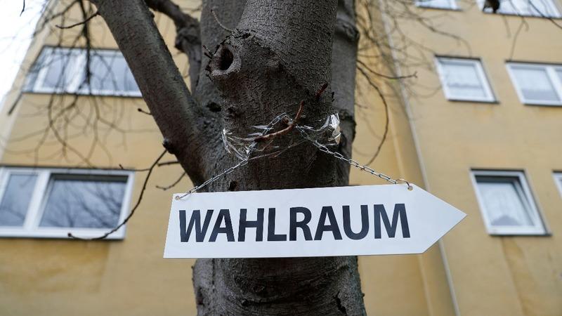 Merkel's government braces as Hesse polls open