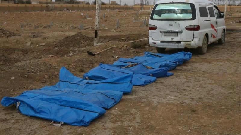One year on, Syrians in Raqqa bury their dead