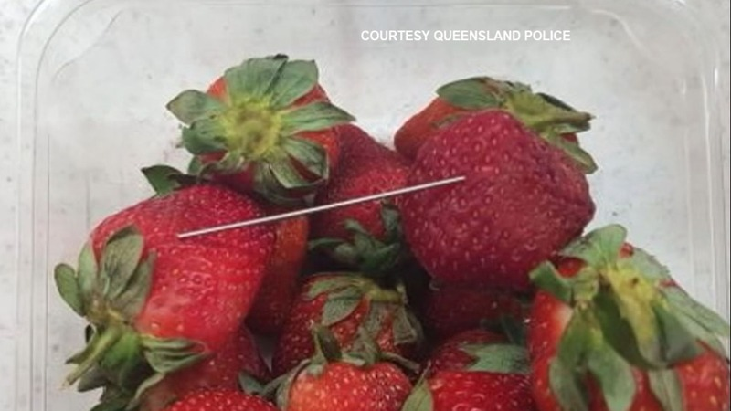 Woman charged in Australia's strawberry scare
