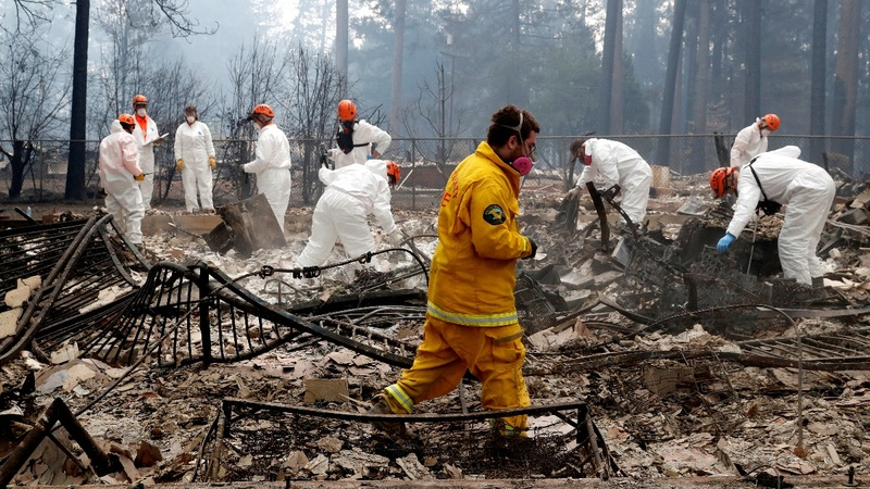 Teams look for bones as California wildfires rage