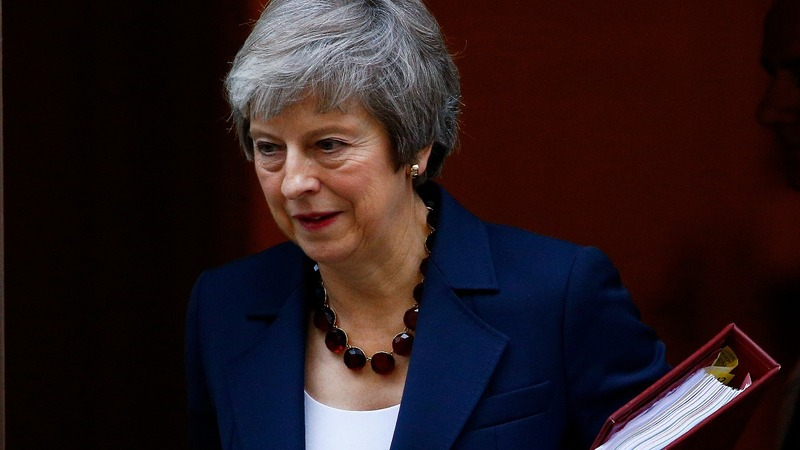 Brexit battle begins as May faces resignations