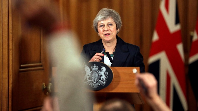 May holds onto her Brexit plan and job - for now