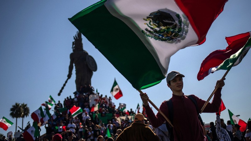 Protests greet migrant caravan in Tijuana