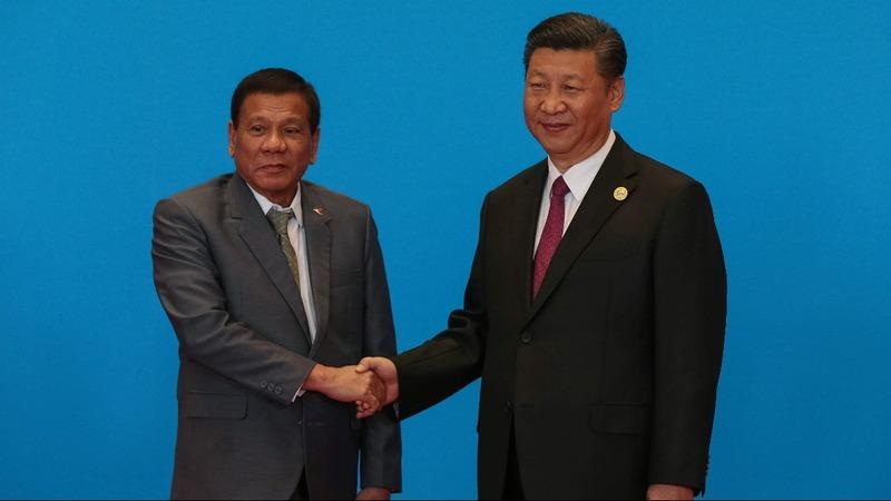 Xi visits Manila as Duterte pressed to take tougher line
