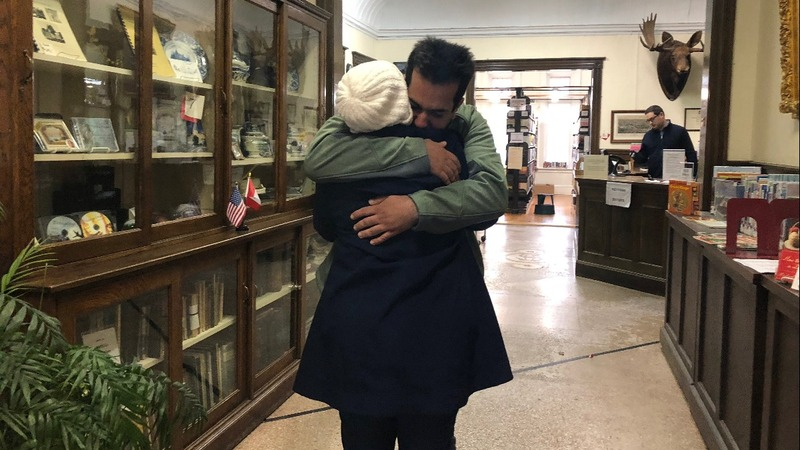 Separated by travel ban, Iranians reunite at library