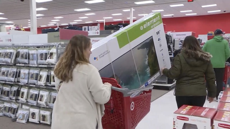 Holiday shoppers get busy in store and online
