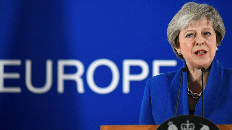 EU seals Brexit deal, urges Britons to back May