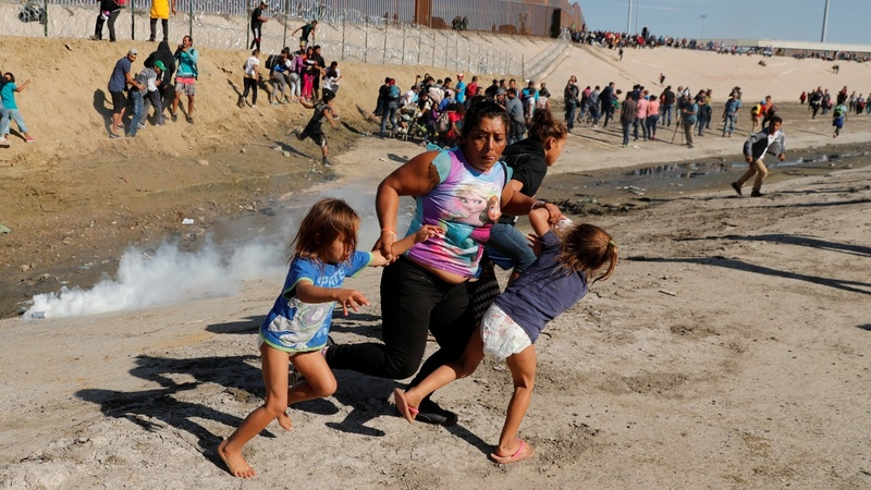 U.S. fires tear gas into Mexico to repel migrants
