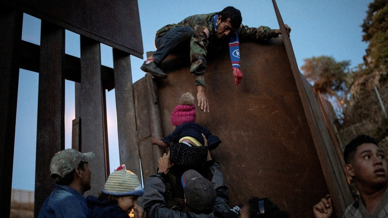 Tired of asylum process, migrants breach border