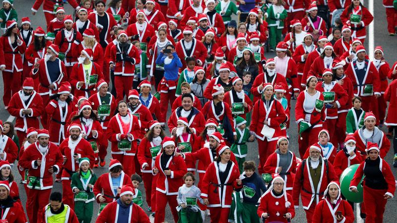 INSIGHT: Thousands of Santas race through Madrid