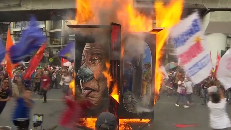 Manila activists protest military law plans