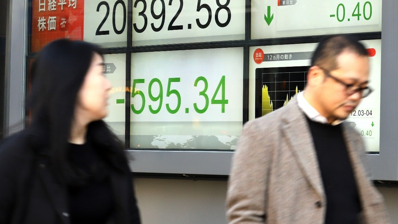 Asia, Europe stocks slide after Fed rate hike