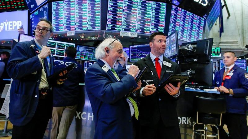Wall Street roars back late to keep rally going