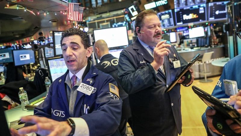 Wall Street swings as it caps off wild week