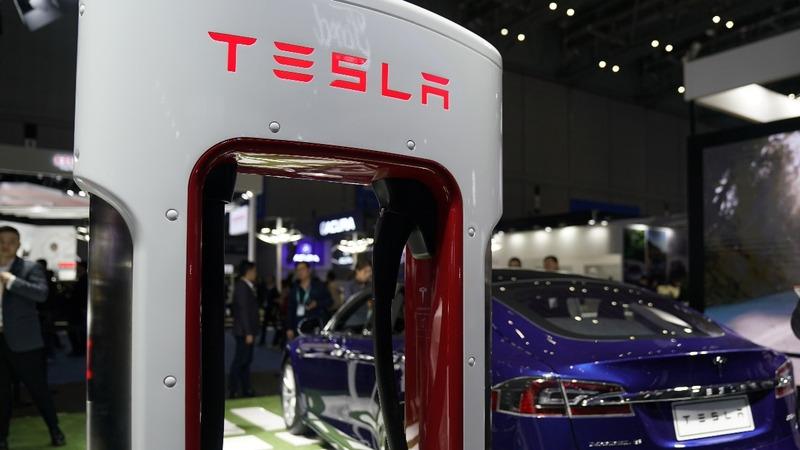 Tesla shares fall on vehicle price cut