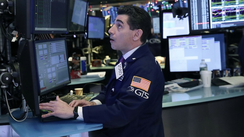 Wall Street jittery, Apple lowers forecast
